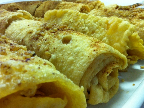 The ladies offer you Diples, sweet, fried ribbons of pastry  splashed with a honey syrup, a sprinkling of chopped walnuts and finally dusted with a pinch of cinnamon.  Can you stand it?