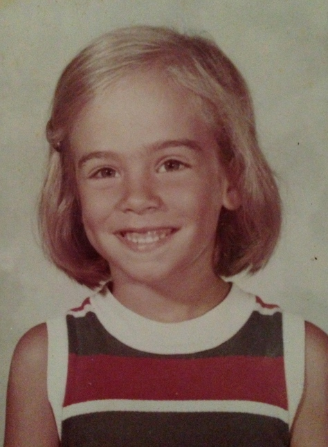 Pamela in a typical Florence Eiseman dress. She was in 1st grade. Poor thing.