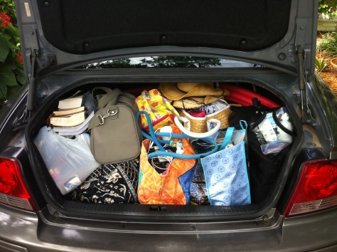 Three little days and the car is PACKED!  Andrea has a different hat for every day.  We.Are.Girls.