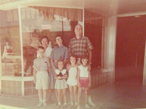 When we were older there were NO smiling faces when we had to change the window. Cynthia and I are in the middle with Mom and Dad behind us. 1960