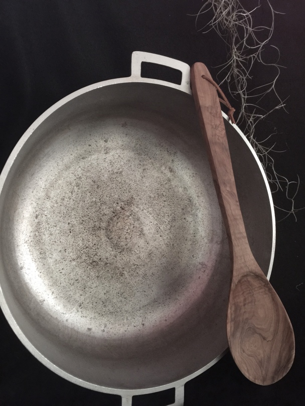 My pot holds 3.5 gallons.  the spoon could probably be used as a paddle in a row boat!